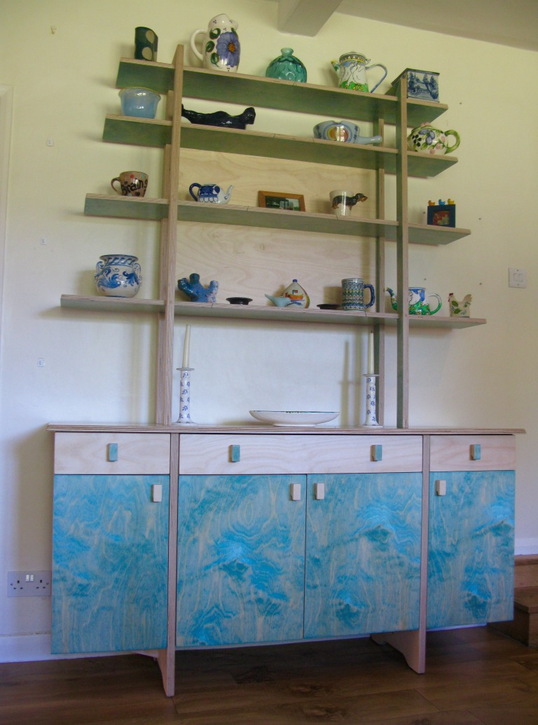 a modern dresser with an light, open rack: birch ply and a ragged effect blue varnish