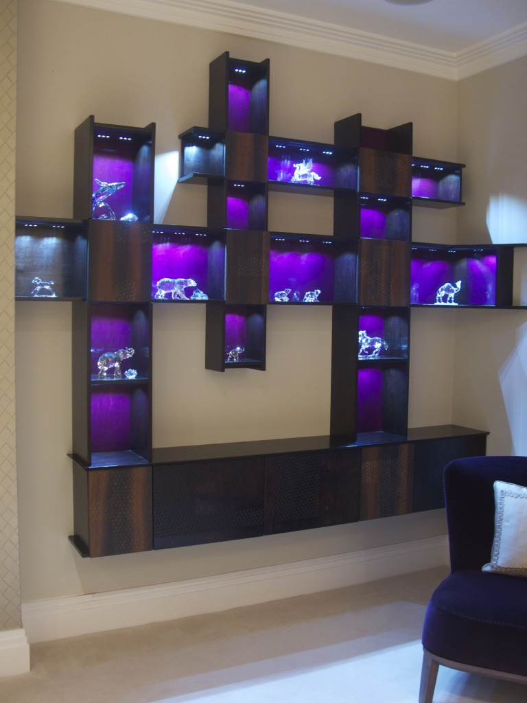 display unit for lounge area in stained birch ply with luscious bog oak doors and dimmable leds.