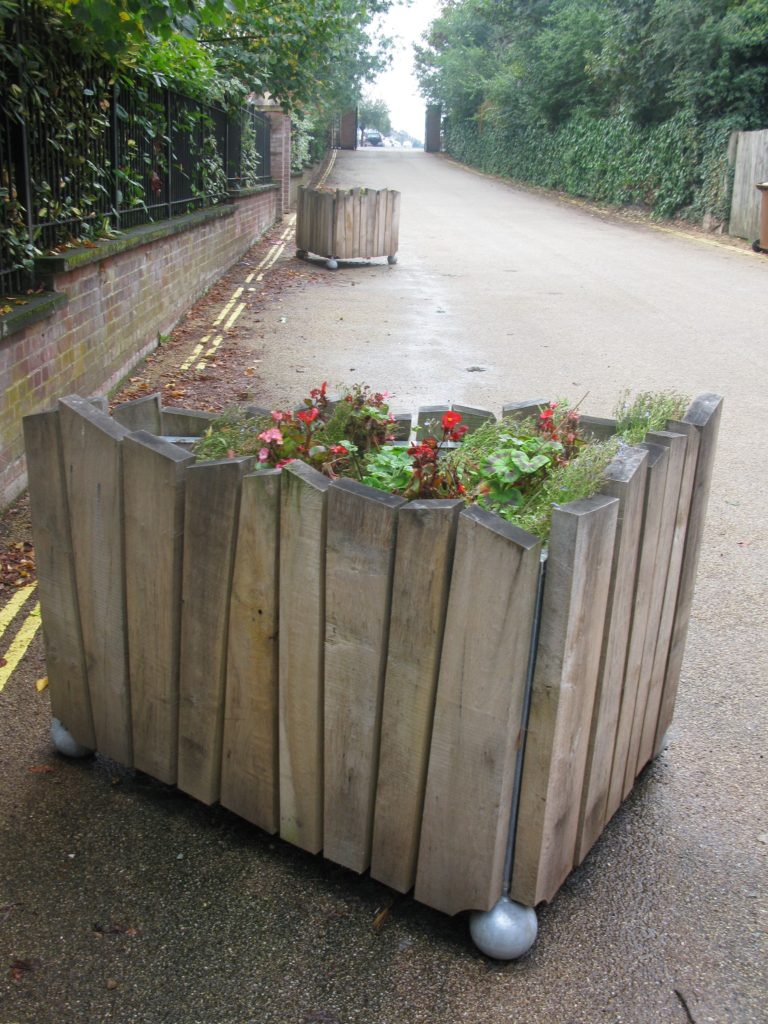 set of 3 planters made from storm-felled oak from the park, with recycled plastic interiors