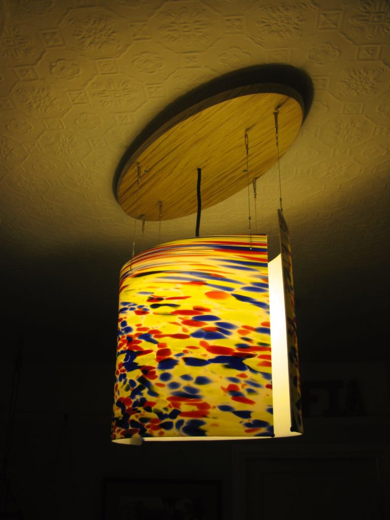 suspended ceiling light with curved glass by danielle hopkinson