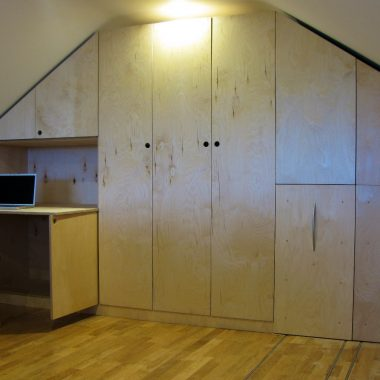 attic wardrobes: birch ply, wheeled units on rails