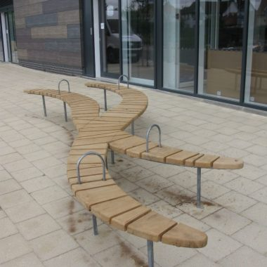 outdoor bench in the shape of a logo