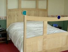 oak and coloured glass bed