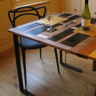 extension table in walnut, bog oak and steel