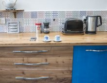 kitchen in solid english elm and cobalt-stained birch ply