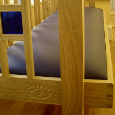 reception bench in solid, local, sustainable oak and blue glass